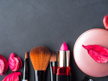 Make up products and tools with pink petals Royalty Free Stock Photography