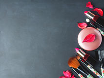 Make up products and tools with pink petals Stock Photography