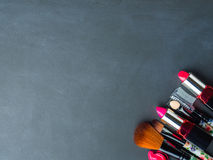 Make up products and tools with pink petals Royalty Free Stock Image