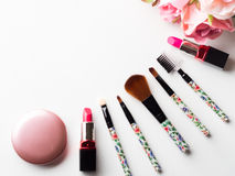 Make up products and tools with pink roses flowers on white Stock Photos