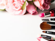 Make up products and tools with pink roses flowers on white Stock Photo