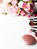 Make up products and tools with pink roses flowers on white Royalty Free Stock Photos