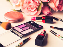 Make up products and tools with pink roses Royalty Free Stock Photography