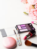 Make up products and tools with pink roses Stock Photography