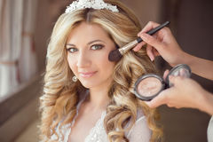 Make up rouge. Healthy hair. beautiful smiling bride wedding por. Trait. Stylish makes makeup Young woman with long curly hair style stock photography