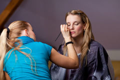 Make-up session - two young women Royalty Free Stock Photo