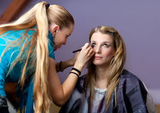 Make-up session - two young women Royalty Free Stock Images