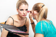 Make-up session - white background Royalty Free Stock Photo