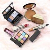 Make up set. Glamorous set of cosmetics. Lipsticks, powder and eye shadow Royalty Free Stock Photography