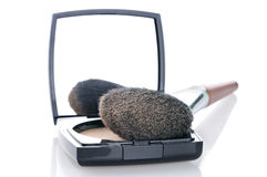 Make-up set. Make-up brush on powder-case with mirrow. Selective focus on front Royalty Free Stock Photos
