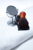 Make-up set with mirror on towel on isolated white Royalty Free Stock Photography