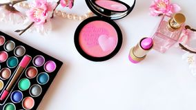 Make up set, pearls, bottle of perfume and flowers stock photography