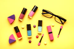 Make up set on yellow background top view Royalty Free Stock Images