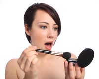 Make up shock and surprise with cosmetic compact Stock Photos