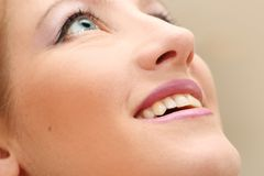 Make-up on smiling woman face. Close up of a smiling woman face Stock Images