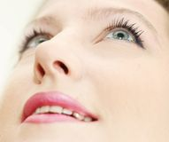 Make-up in smiling woman face. Close up of a smiling woman Stock Image