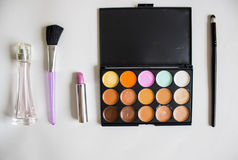 Make-up tools. Corrector, perfume, brush and lipstick Stock Image