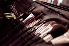 Make up tools. A set of various make-up tools, brushes and other accessories in a carrier stock image