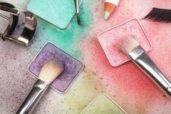 Make-up tools on white. Set of make-up tools: palettes, brushes, pen, eyelashes and curler on white royalty free stock images