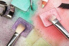 Make-up tools on white. Set of make-up tools: palettes, brushes, pen, eyelashes and curler on white Royalty Free Stock Images