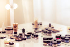 Make up tools on the white table. Eyeshadow, blush, concealer, p. Owder Stock Photography
