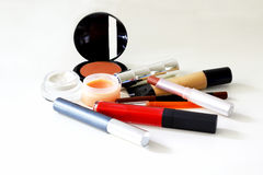 Make-up. Used cosmetics spread on the white surface Royalty Free Stock Image