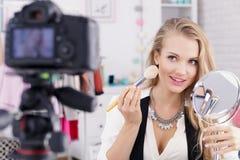 Make up vlogger with mirror. Beautiful make up vlogger with mirror recording tutorial stock photos