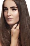 Make-up, wellness. Beautiful model with long shiny hair Royalty Free Stock Photo