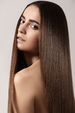 Make-up, wellness. Beautiful model with long shiny hair Royalty Free Stock Photography