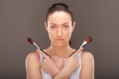 Make-up in western movie style. A young lady is preparing for an evening event Royalty Free Stock Image