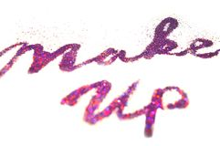 Make Up, words of purple glitter sparkle on white background with bokeh lights Stock Photo