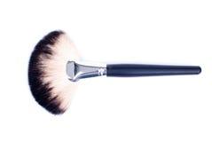 Make-upborstel op een geïsoleerde achtergrond Stock Afbeelding