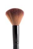 Make-upborstel op witte achtergrond Stock Foto's