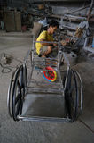 Make wheelchairs. Technicians are making wheelchairs for the disabled in a workshop in the city of Solo, Central Java, Indonesia Royalty Free Stock Images
