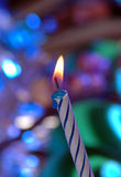 Make a wish. Single birthday candle Royalty Free Stock Image