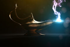 Make a wish. Ancient magic lamp in dark place Royalty Free Stock Photos