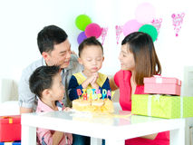 Make a wish. Asian boy make a wish on his birthday party royalty free stock photography