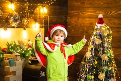 Make wish. Best wishes for you your family this christmas. Merry christmas and happy new year. Cute boy play near royalty free stock photography