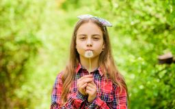 Make a wish. dandelion. Spring holiday. Womens day. little girl and with taraxacum flower. Natural beauty. Childhood royalty free stock photography