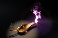 Make a wish. Magic lamp upside view in dark place Stock Images