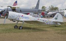 Make A Wish Mid-Atlantic Plane. OSHKOSH, WI - JULY 27: The Make A Wish Mid-Atlantic plane with colorful children's handprints on display at the  2012 AirVenture Stock Photography