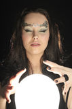 Make wishing with a Magic crystal ball. Witch make wishing with a Magic crystal ball Royalty Free Stock Photo