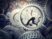 Make it works. Running businessman in huge abstract gear stock photos