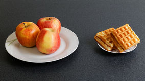 Make Your Choice  - Apples or Cookies Royalty Free Stock Photos