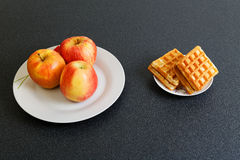 Make Your Choice  - Apples or Cookies Royalty Free Stock Photography