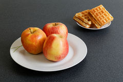 Make Your Choice  - Apples or Cookies Stock Photography