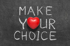 Make your choice. Phrase handwritten on blackboard with heart symbol instead of O Royalty Free Stock Image