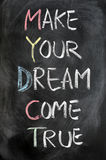 Make your dream come true. Written on blackboard Royalty Free Stock Images