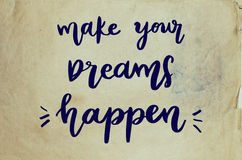 Make your dreams happen handwritten message. On old paper Royalty Free Stock Photos
