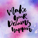 Make your dreams happen. Inspirational quote about dream, goals, life. Brush lettering on pink and violet watercolor Stock Photo